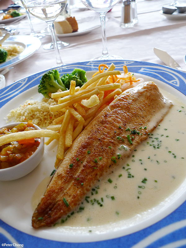 lake trout from lac du jour, grilled, with a butter sauce and french fries at hotel bellevue le rocheray le sentier