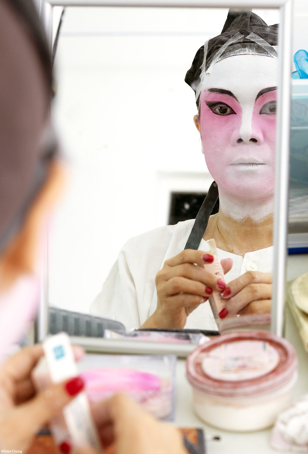opera performer doing makeup